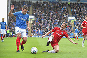 Portsmouth Midfielder, Gareth Evans (26) and Accrington Stanley Midfielder, Sean McConville (11) during the EFL Sky Bet League 1 match between Portsmouth and Accrington Stanley at Fratton Park, Portsmouth, England on 4 May 2019.
