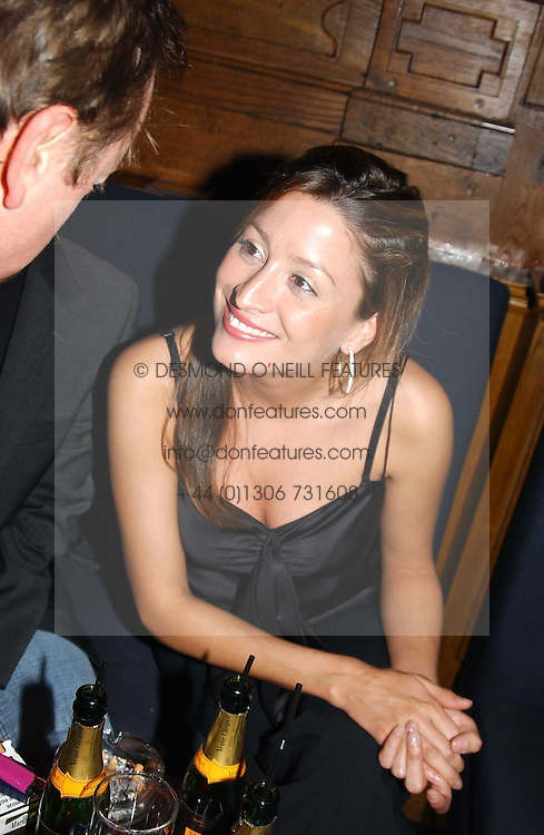 MISS REBECCA LOOS at a party hosted by Tatler magazine to celebrate the publication of the 2004 Little Black Book held at Tramp, 38 Jermyn Street, London SW1 on 10th November 2004.<br />