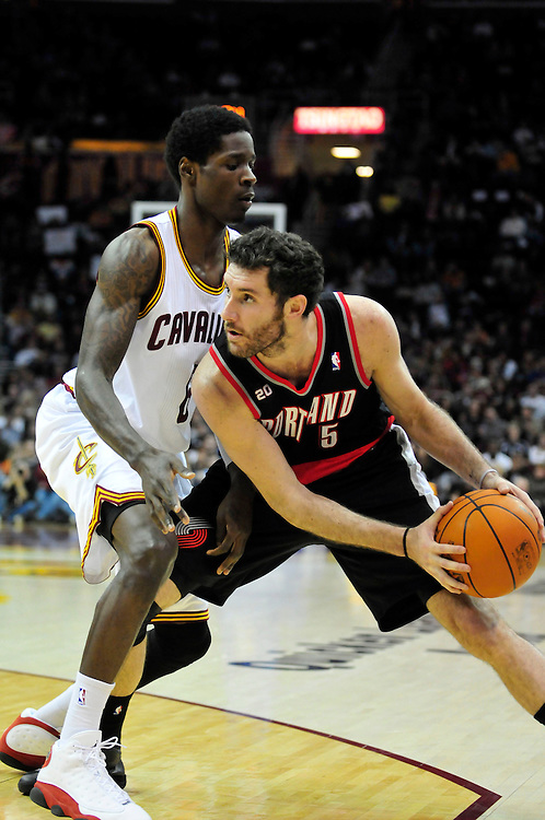 Feb. 5, 2011; Cleveland, OH, USA; Portland Trail Blazers shooting guard Rudy Fernandez (5) looks for a pass around Cleveland Cavaliers guard Christian Eyenga (8) during the third quarter at Quicken Loans Arena. The Trail Blazers beat the Cavaliers 111-105. Mandatory Credit: Jason Miller-US PRESSWIRE
