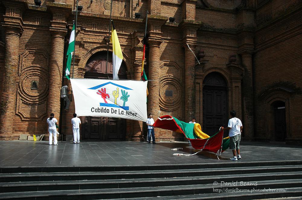 Children setting banners in front of church, Santa Cruz, Bolivia