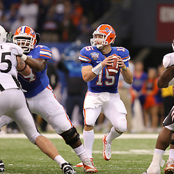 Jan 01, 2010; New Orleans, LA, USA;  Florida Gators quarterback Tim Tebow (15) looks to pass against the Cincinnati Bearcats during the first half of the 2010 Sugar Bowl at the Louisiana Superdome.  Mandatory Credit: Derick E. Hingle-US PRESSWIRE.