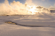 A solfatara, smoke and hot rivers on a sunny morning in the winter, geothermal area Hveravellir, Highlands, Icland