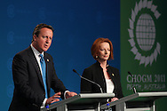 PERTH, AUSTRALIA - OCTOBER 28:  Prime Minister of the United Kingdom David Cameron and Prime Minister of Australia Julia Gillard address the media during a press conference during the Commonwealth Heads of Government Meeeting on October 28, 2011 in Perth, Australia. Queen Elizabeth II opened the 54-nation summit today, following a 9-day tour of Australia. The three-day biennial gathering is chaired by Australian Prime Minister, Julia Gillard and concludes on October 30.  (Photo by Paul Kane/Getty Images)