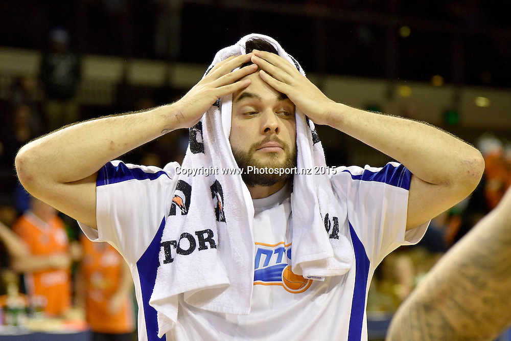 Izayah of the Saints stands dejected after their loss during the NBL final basketball match between Wellington Saints and Southland Sharks at the TSB Arena in Wellington on Sunday the 5th of July 2015. Copyright photo by Marty Melville / www.Photosport.nz
