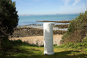 White marker post by sandy beach, Island of Herm, Channel Islands, Great Britain