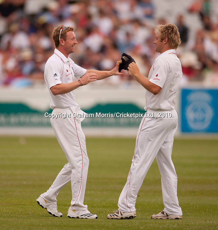 Guess who forgot his (traditional first morning) cap?  Paul Collingwood celebrates 12th man Luke Wright (right) bringing his cap on the field as if it were a wicket during the third Test Match between South Africa and England at Newlands, Cape Town. Photograph © Graham Morris/cricketpix.com (Tel: +44 (0)20 8969 4192; Email: sales@cricketpix.com)