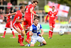 Ollie Clarke of Bristol Rovers is tackled by Scott Wootton of Milton Keynes Dons - Mandatory by-line: Dougie Allward/JMP - 28/10/2017 - FOOTBALL - Memorial Stadium - Bristol, England - Bristol Rovers v Milton Keynes Dons - Sky Bet League One