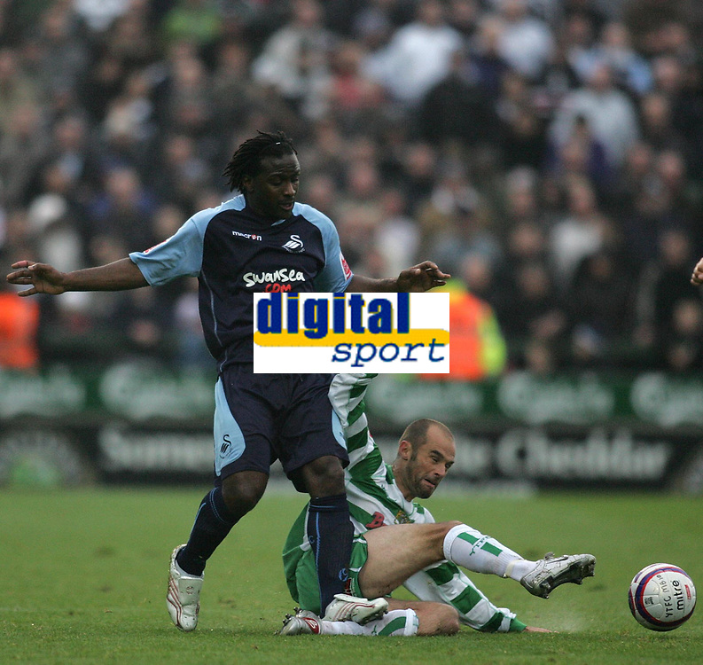 Photo: Lee Earle.<br />Yeovil Town v Swansea City. Coca Cola League 1. 27/10/2007. Swansea's Jason Scotland (L) clashes with Paul Warne