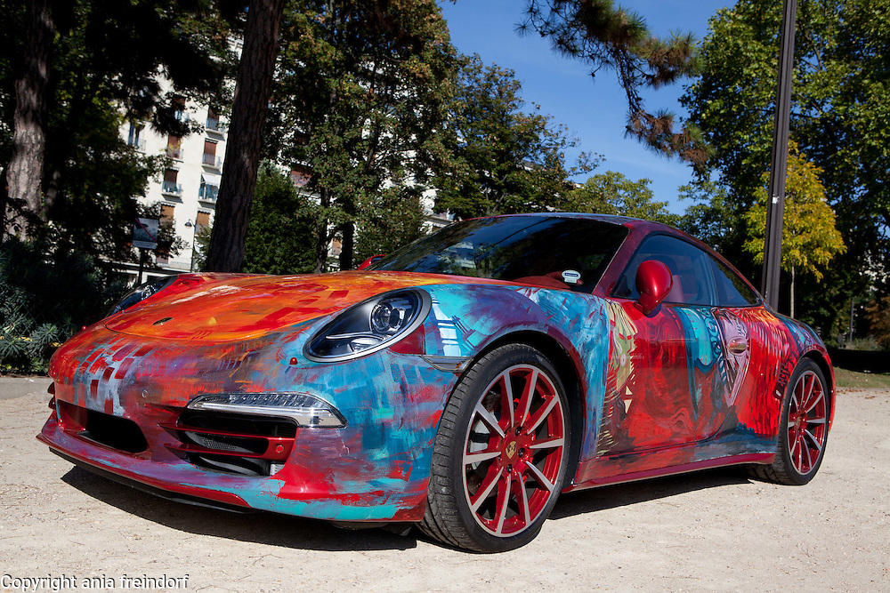 "Saudi artist Shalimar Sharbatly, ""Shalemar"", her art, painting on a Porsche car, Paris, France."