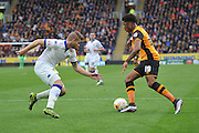 Hull City striker Chuba Akpom (19) up against Gaetano Berardi (28) of Leeds United during the Sky Bet Championship match between Hull City and Leeds United at the KC Stadium, Kingston upon Hull, England on 23 April 2016. Photo by Ian Lyall.
