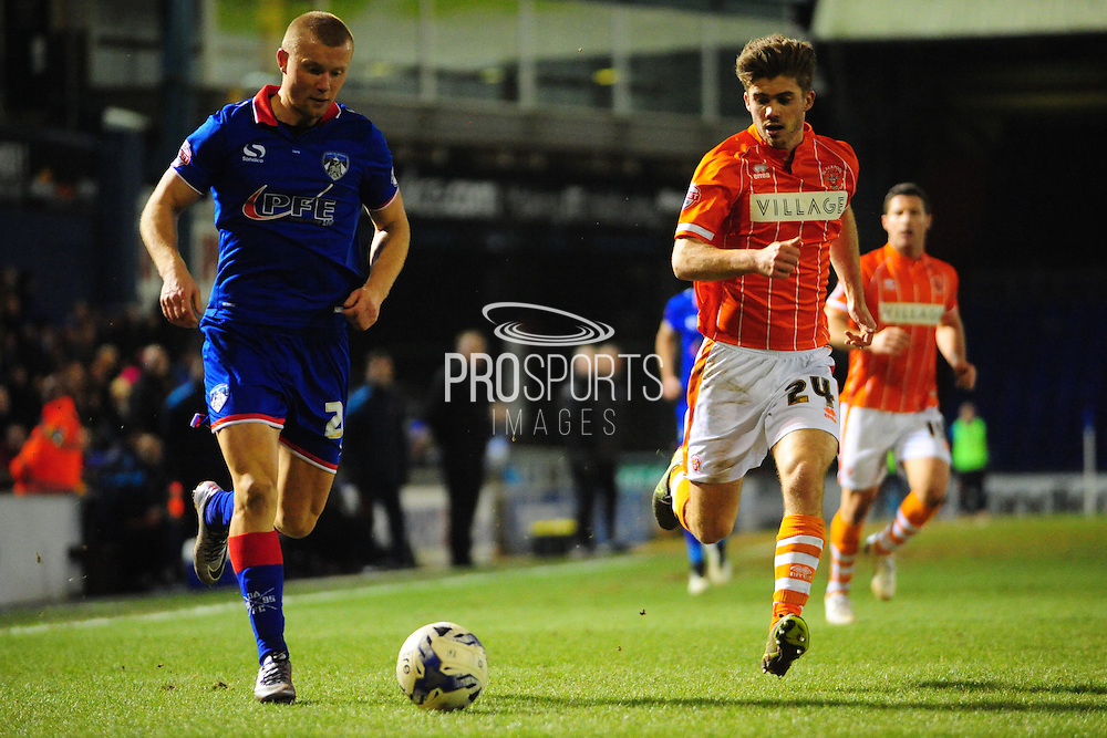 Curtis Main of Oldham Athletic (on loan from Doncaster Rovers) takes on Luke Higham of Blackpool FC during the Sky Bet League 1 match between Oldham Athletic and Blackpool at SportsDirect.Com Park, Oldham, England on 15 March 2016. Photo by Mike Sheridan.