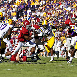 November 6, 2010; Baton Rouge, LA, USA; Alabama Crimson Tide running back Trent Richardson (3) is pursued on a play by LSU Tigers cornerback Morris Claiborne (17), defensive tackle Drake Nevis (92) and defensive end Barkevious Mingo (49) during the first half at Tiger Stadium.  Mandatory Credit: Derick E. Hingle
