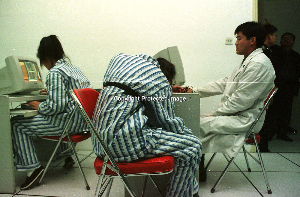BEIJING, 2000: a juvenile drug offender  during a health check at the Ankang drug  rehabilitation centre in Beijing. Those who are confirmed HIV positive ,move to a special ward.HIV is mostly transitted in China through drug users.