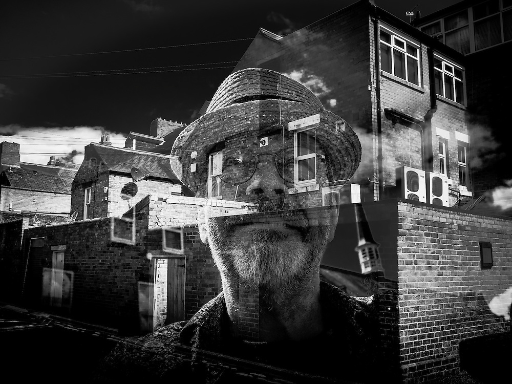 male face over old street buildings