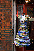 A countryside printed dress with panoramas of horses outside of a shop in London's Soho.