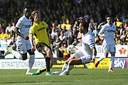 Jackson Irvine is Halted by Kemar Roofe. during the EFL Sky Bet Championship match between Burton Albion and Leeds United at the Pirelli Stadium, Burton upon Trent, England on 22 April 2017. Photo by John Potts.