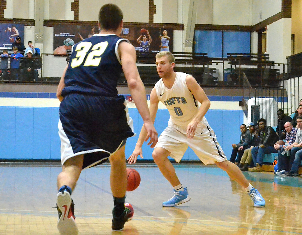 2/5/16 – Medford/Somerville, MA – Tufts guard Ben Engvall, A18, evades a Trinity defender in the men's basketball game against Trinity on Feb. 5, 2016. (Laura de Armas / The Tufts Daily)