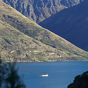 The TSS Earnslaw,  a 1912 Edwardian vintage twin screw steamer on the waters of Lake Wakatipu in, Queenstown, New Zealand. .It is one of the oldest tourist attractions in Central Otago, and the only remaining passenger-carrying coal-fired steamship in the southern hemisphere..The TSS Earnslaw heads along Lake Wakatipu from Queenstown  daily, running tourist trips to Walter Peak Station passing magnificent  peaks and contrasting shoreline foliage along the lakeside. Queenstown, New Zealand. 12th March 2011. Photo Tim Clayton