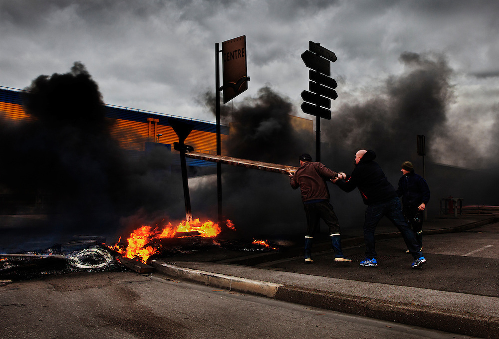 Striking fisherman, protesting about the low price of fish, block the main road artery in the port&rsquo;s fish processing district, Cap&eacute;cure, with burning tyres. Boulogne-sur-Mer, France.<br /> <br /> Along with the rising costs of fishing, the low price fishermen are paid for their catch is an issue that is threatening many of the E.U. fishing communities. <br /> <br /> There is widespread anger and fear that vessels will have to be de-commissioned, fishermen&rsquo;s jobs will be lost and the character of fishing ports changed forever.