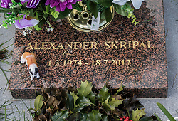 © Licensed to London News Pictures. 07/03/2018. Salisbury, UK. A toy dog and floaral tributes decorate the grave of Alexander Skripal son of former Russian spy Sergei Skripal who has become ill, along with his daughter Julia, with suspected poisoning in Salisbury, England. The couple where found unconscious on bench in Salisbury shopping centre. Specialist units have been called in to deal with any possible contamination. Photo credit: Peter Macdiarmid/LNP