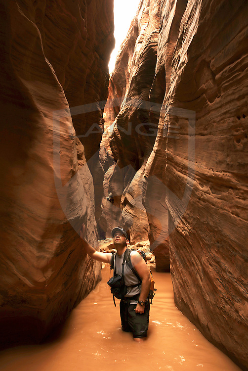 explorer in buckskin gulch slot canyon.  grand staircase escalante national monument, utah.