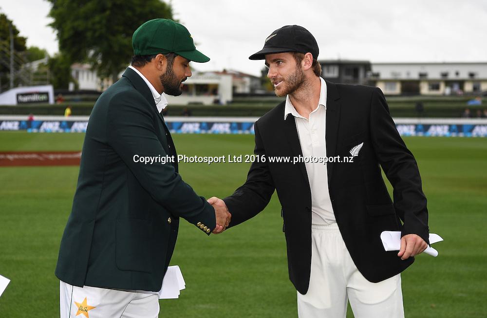 Pakistan captain Azhar Ali and NZ captain Kane Williamson shake hands at the wicket.<br /> New Zealand Black Caps v Pakistan. Day 1, 2nd test match. Friday 25 November 2016. Seddon Park, Hamilton, New Zealand. &copy; Copyright photo: Andrew Cornaga / www.photosport.nz