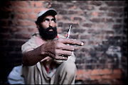 "Seconds before an heroin injection. Morgh Mandi, Rawalpindi, Pakistan, on friday, November 28 2008.....""Pakistan is one of the countries hardest hits by the narcotics abuse into the world, during the last years it is facing a dramatic crisis as it regards the heroin consumption. The Unodc (United Nations Office on Drugs and Crime) has reported a conspicuous decline in heroin production in Southeast Asia, while damage to a big expansion in Southwest Asia. Pakistan falls under the Golden Crescent, which is one of the two major illicit opium producing centres in Asia, situated in the mountain area at the borderline between Iran, Afghanistan and Pakistan itself. .During the last 20 years drug trafficking is flourishing in the Country. It is the key transit point for Afghan drugs, including heroin, opium, morphine, and hashish, bound for Western countries, the Arab states of the Persian Gulf and Africa..Hashish and heroin seem to be the preferred drugs prevalence among males in the age bracket of 15-45 years, women comprise only 3%. More then 5% of whole country's population (constituted by around 170 milion individuals),  are regular heroin users, this abuse is conspicuous as more of an urban phenomenon. The substance is usually smoked or the smoke is inhaled, while small number of injection cases have begun to emerge in some few areas..Statistics say, drug addicts have six years of education. Heroin has been identified as the drug predominantly responsible for creating unrest in the society."""