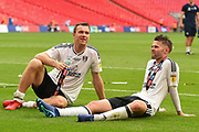 Fulham midfielder Kevin McDonald (6) and Fulham midfielder Oliver Norwood (16) relax on the pitch in front of the Fulham supporters during the EFL Sky Bet Championship play-off final match between Fulham and Aston Villa at Wembley Stadium, London, England on 26 May 2018. Picture by Jon Hobley.