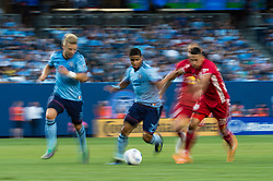 July 8, 2018 - Bronx, New York, United States - New York City midfielder ISMAEL TAJOURI (29) dribbles the ball against New York Red Bulls midfielder FLORIAN VALOT (22) while New York City defender ANTON TINNERHOLM (3) looks on during a regular season match at Yankee Stadium in Bronx, NY.  New York City FC defeats the New York Red Bulls 1 to 0 (Credit Image: © Mark Smith via ZUMA Wire)