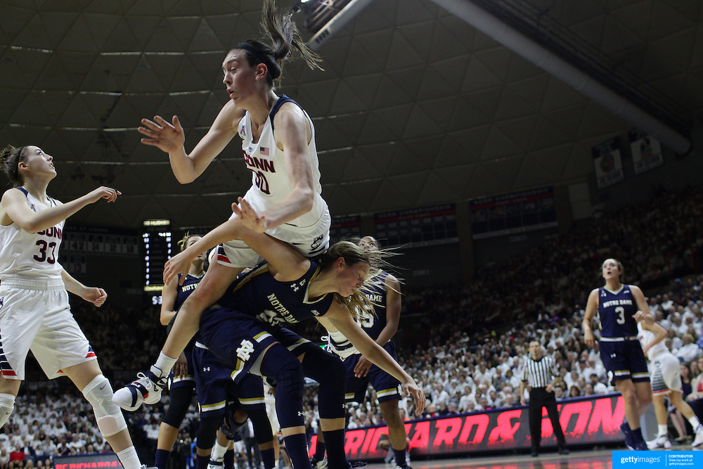 Breanna Stewart, UConn, climbs above Madison Cable, Notre Dame, to tip in a rebound during the Notre Dame Vs UConn Women's Basketball game at Grampel Pavilion, Storrs, Connecticut, USA. 5th December 2015. Photo Tim Clayton