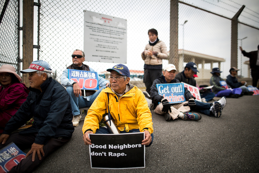 OKINAWA, JAPAN - FEBRUARY 1 : Anti U.S. Base protesters with placards sit outside of the U.S Marine Camp Schwab gate to protest against the construction of the new U.S Marine Airbase in Nago, Okinawa, Japan on Wednesday, February 1, 2017. Okinawa Gov. Takeshi Onaga arrived in the United States on Tuesday, aiming to convey to President Donald Trump's administration local opposition to a plan to relocate a U.S. airbase within the southern island prefecture. (Photo by Richard Atrero de Guzman/NURPhoto)