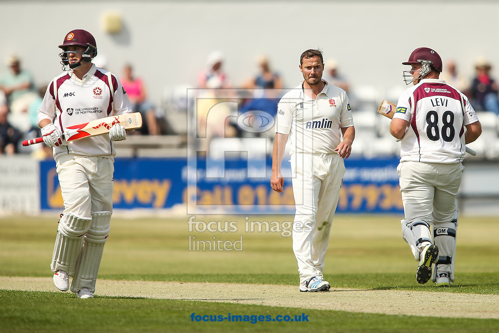 Graham Napier of Essex (centre) looks on as Josh Cobb of Northamptonshire (left)  and Richard Levi of Northamptonshire (right) take a run during the LV County Championship Div Two match at the County Ground, Northampton<br /> Picture by Andy Kearns/Focus Images Ltd 0781 864 4264<br /> 08/06/2015