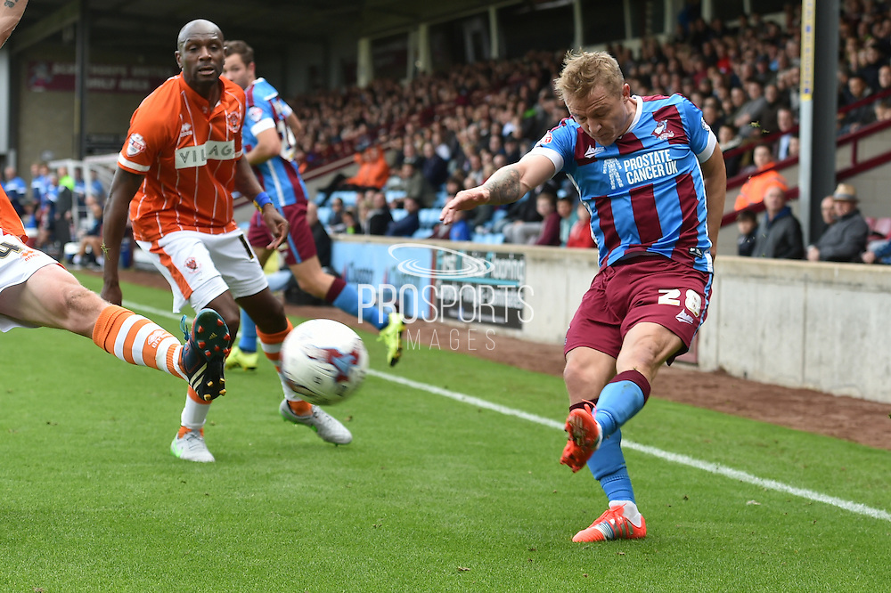 Gary McSheffrey  ties to cross the ball during the Sky Bet League 1 match between Scunthorpe United and Blackpool at Glanford Park, Scunthorpe, England on 5 September 2015. Photo by Ian Lyall.