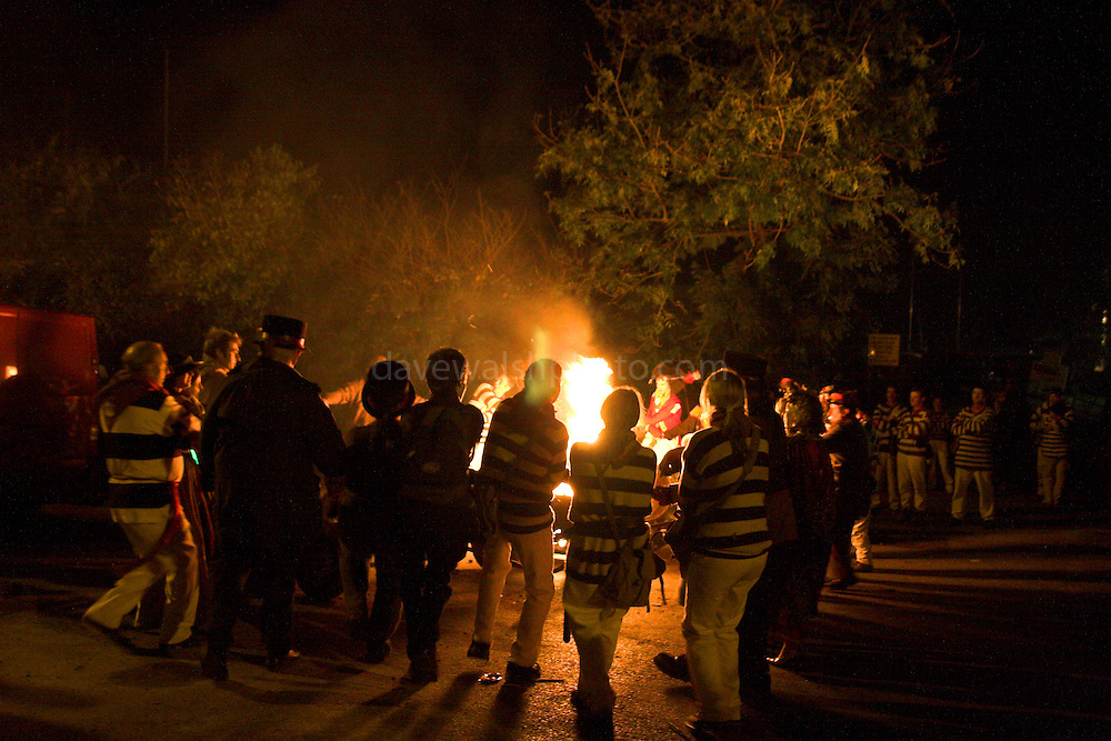 Members of a bonfire society dance around a fire in Lewes 5/11/05