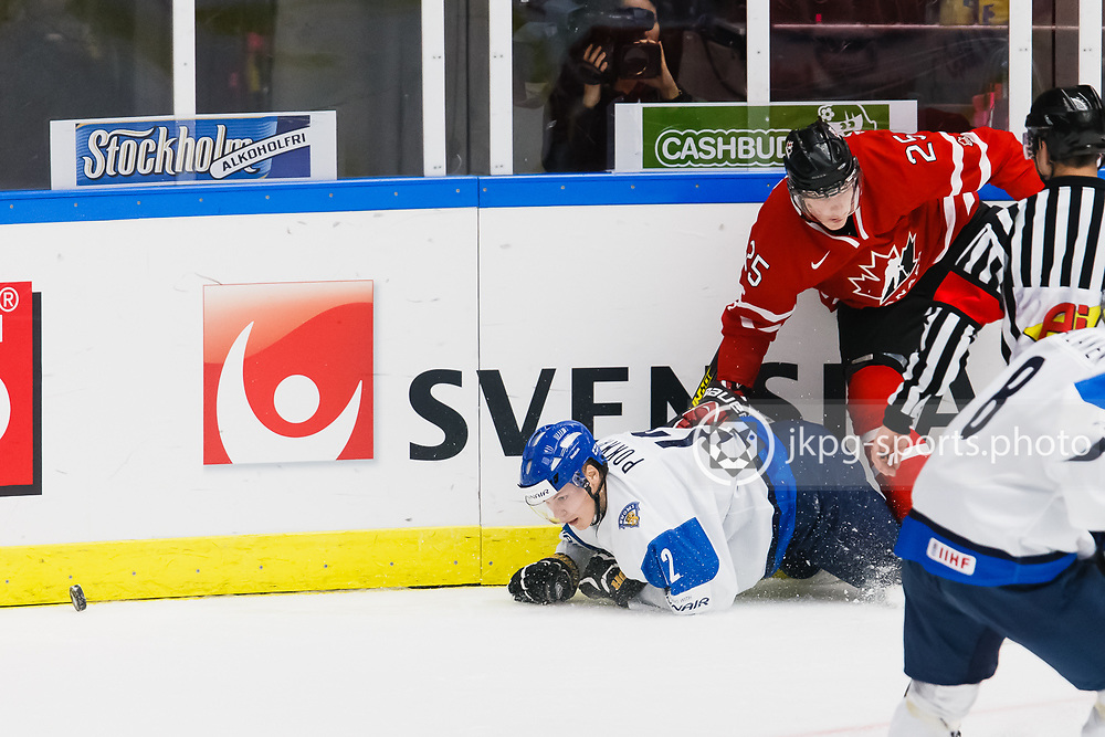 140104 Ishockey, JVM, Semifinal,  Kanada - Finland<br /> Icehockey, Junior World Cup, SF, Canada - Finland.<br /> Ville Pokka, (FIN), Josh Anderson, (CAN).<br /> Endast f&ouml;r redaktionellt bruk.<br /> Editorial use only.<br /> &copy; Daniel Malmberg/Jkpg sports photo