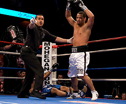 Apr 6, 2007; Uncasville, CT, USA; Matt Godfrey (white trunks) knocks down Felix Cora Jr. (blue trunks) in the second round of their 12 round NABF and NABA Cruiserweight title bout at the Mohegan Sun Arena.