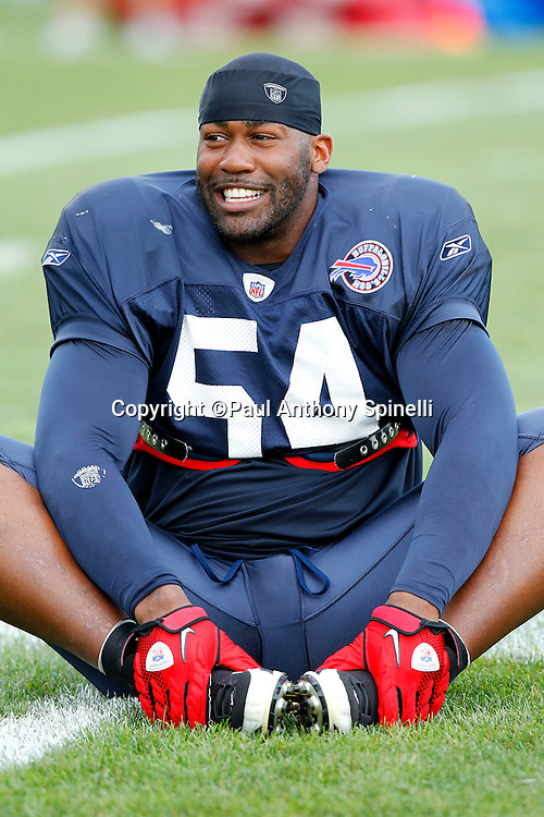 NFL Buffalo Bills free agent linebacker Andra Davis (54) smiles as he stretches during training camp at St. John Fisher College on August 5, 2010 in Pittsford, New York. (©Paul Anthony Spinelli)