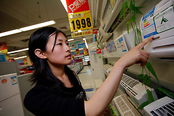 CHINA SHANGHAI 19MAY10 - A Chinese customer is shopping for energy-rated white goods with the help of a shop assistant at a Tesco retail store in Changning, downtown Shanghai. ..jre/Photo by Jiri Rezac..© Jiri Rezac 2010