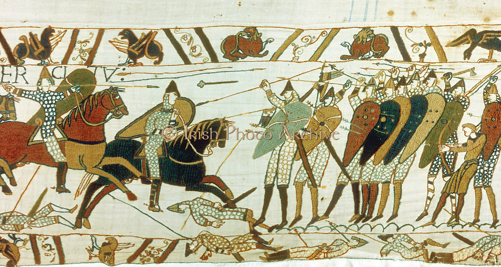 Bayeux Tapestry 1067.  Battle of Hastings, 14 October 1066. Anglo-Saxon (English) foot soldiers defend themselves with wall of shields against Norman cavalry. Men lie dead and wounded. Invasion Lance Axe Arrow Bow  Textile Linen