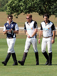 The Duke of Sussex and Duchess of Sussex are seen at the end of the Sentebale ISPS Handa Polo Cup at the Royal Berkshire Polo Club today.<br /><br />27 July 2018.<br /><br />Please byline: Vantagenews.com