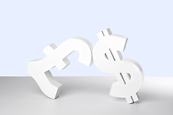 Dollar and Pound signs on white background (Credit Image: © Image Source/Howard Bartrop/Image Source/ZUMAPRESS.com)