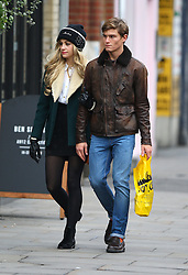 Singer Pixie Lott and her model boyfriend Oliver Cheshire out shopping in London. Pixie wearing long hair extensions a black Moschino woolly hat, green jacket with fur collar, white blouse, leather gloves, short black skirt, ankle boots and a orange hand bag that matched Oliver's socks. The young couple seemed very much in love as they walked hand in hand around the shops, where Pixie tried on a jacket and bought a paisley skirt. After shopping the pair grabbed a bite to eat at Pilpel's falafel & houmous bar before heading home... UK. 25/10/2012<br />BYLINE MUST READ : JAMESY/GOTCHA IMAGES<br /><br />Copyright by © Gotcha Images Ltd. All rights reserved.<br />Usage of this image is conditional upon the acceptance <br />of Gotcha Images Ltd, terms and conditions available at<br />www.gotchaimages.com