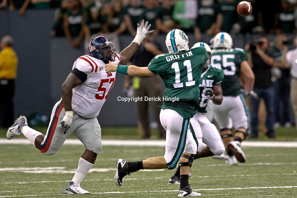 Sep 11, 2010; New Orleans, LA, USA; Mississippi Rebels defensive tackle Jerrell Powe (57) pressures Tulane Green Wave quarterback Ryan Griffin (11)during a game at the Louisiana Superdome. The Mississippi Rebels defeated the Tulane Green Wave 27-13.  Mandatory Credit: Derick E. Hingle