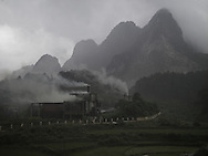 Factory rejecting heavy smokes in a valley of Cao Bang province, Vietnam, Asia.