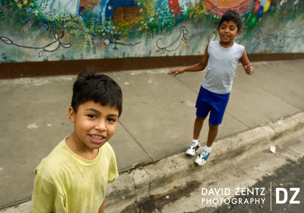 Boys pause while playing in the street in Jinotepe, Nicaragua in September, 2004.