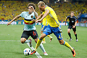 Sweden DF Andreas Granqvist (4) gets past Belgium midfielder Axel Witsel (6) in the box during the Euro 2016 match between Sweden and Belgium at Stade de Nice, Nice, France on 22 June 2016. Photo by Andy Walter.
