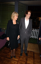 CAMILLA PARKER BOWLES and her son TOM PARKER BOWLES at a party to celebrate the publication of 'E is for Eating' by Tom Parker Bowles held at Kensington Place, 201 Kensington Church Street, London W8 on 3rd November 2004.<br /><br />NON EXCLUSIVE - WORLD RIGHTS