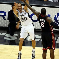 Jun 16, 2013; San Antonio, TX, USA; San Antonio Spurs shooting guard Manu Ginobili (20) passes against Miami Heat small forward LeBron James (6) during the third quarter of game five in the 2013 NBA Finals at the AT&T Center. Mandatory Credit: Derick E. Hingle-USA TODAY Sports