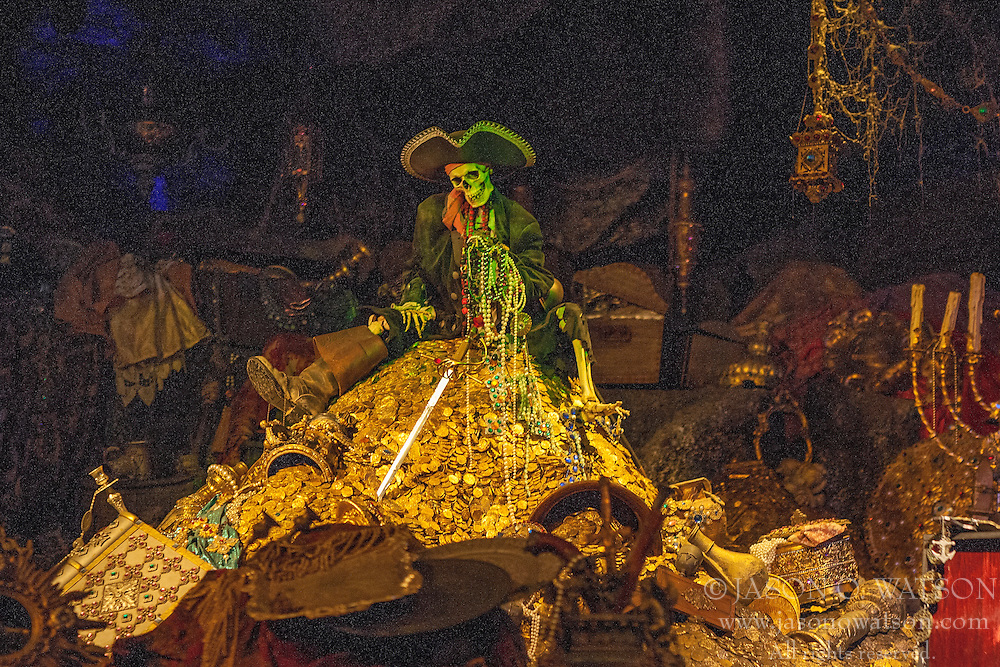 A pirate character sits on gold, Pirates of the Caribbean ride, Disneyland Resort, Anaheim, California, United States of America