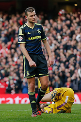 Ben Gibson of Middlesbrough looks dejected after Olivier Giroud of Arsenal scores a goal - Photo mandatory by-line: Rogan Thomson/JMP - 07966 386802 - 15/02/2015 - SPORT - FOOTBALL - London, England - Emirates Stadium - Arsenal v Middlesbrough - FA Cup Fifth Round Proper.